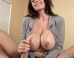 Busty MILF tugging cock and talking dirty