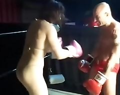 Amazon Female Body Builder vs Man in Belly Punching Boxing Match