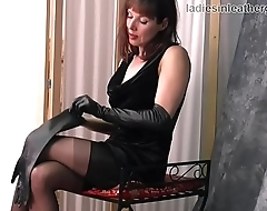 Brunette Milf teases in leather gloves